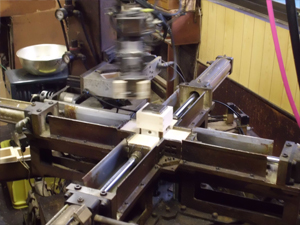 The frame of the masu cups is assembled using this peculiar machine