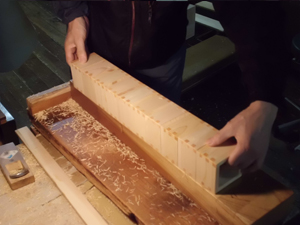 10 pieces of masu cups get all 4 side edges cut off in this step
